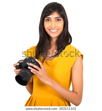 attractive indian woman holding a digital camera - stock photo