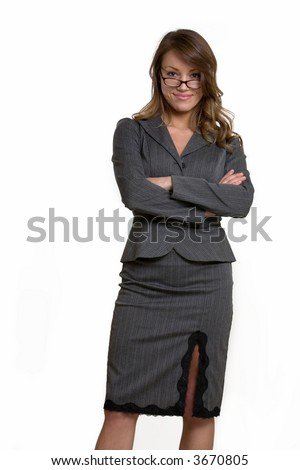 Attractive intelligent looking woman in eyeglasses wearing professional business suit standing with arms crossed on white - stock photo