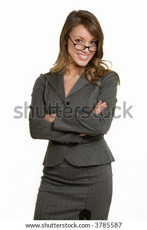 Attractive intelligent looking woman in eyeglasses wearing professional grey colored business suit standing with arms crossed on white - stock photo