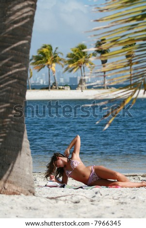 Attractive italian girl tanning on beach