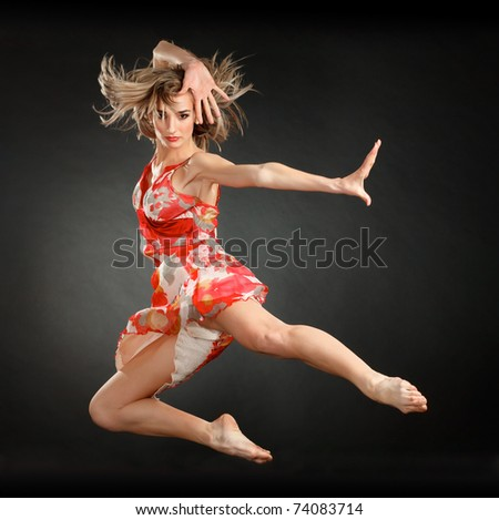 attractive jumping woman dancer - stock photo