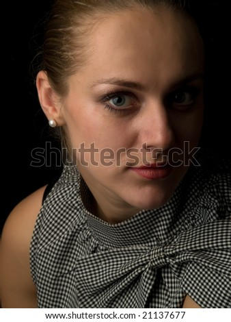 Attractive lady portrait looking to camera black background