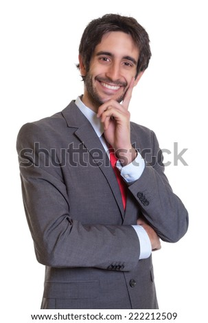 Attractive latin businessman with beard laughing at camera - stock photo
