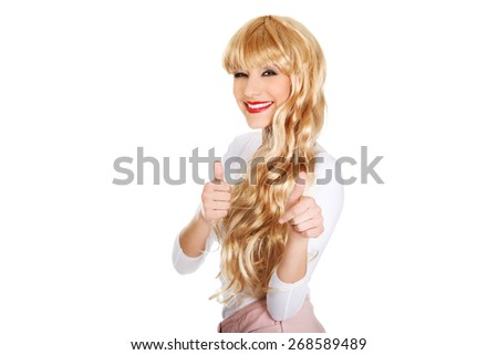 Attractive light blonde woman with thumbs up gesture. - stock photo