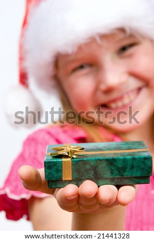 Attractive little girl holding a gift box - stock photo