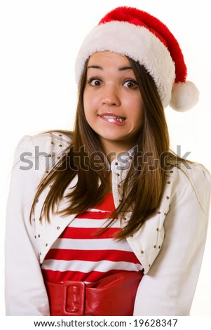 Attractive long haired brunette woman wearing santa hat over white