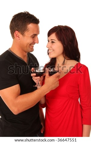 Attractive looking young couple in love enjoying a glass of wine together