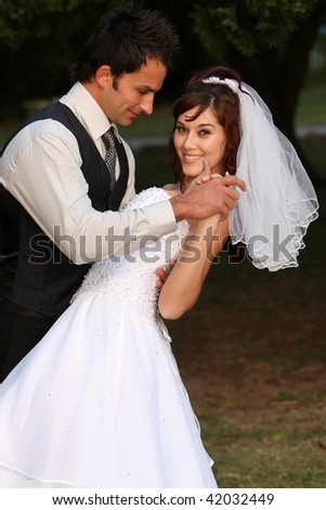 Attractive looking young couple on their wedding day