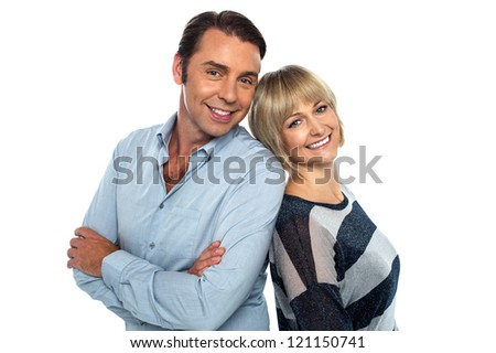 Attractive love couple striking stylish pose isolated against white.