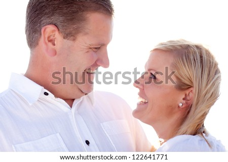 Attractive Loving Caucasian Couple Having Fun Outside Portrait. - stock photo