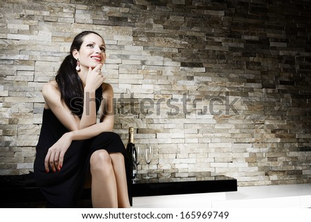 Attractive luxury young woman in party dress - stock photo