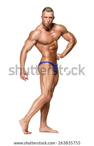 Attractive male body builder, isolated on white background. Portrait in full growth - stock photo