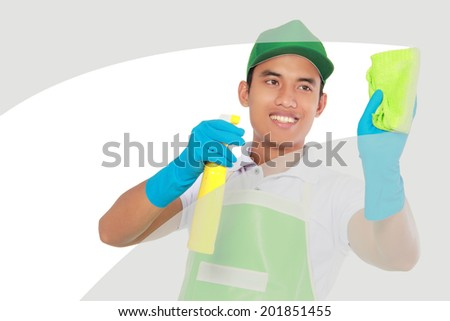 attractive male cleaning glass window using using Soft microfiber cloth - stock photo