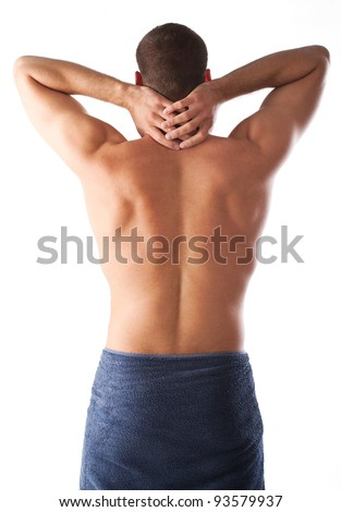 attractive male half naked,wrapped in a towel,showing his body and posing.Image taken from the back.Model holding hands on his neck.Isolation on white - stock photo