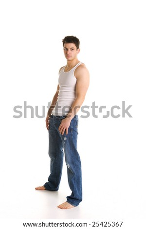 Attractive Male Model wearing worn jeans and white tank top - stock photo