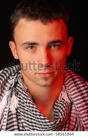 Attractive male model with keffiyeh - stock photo