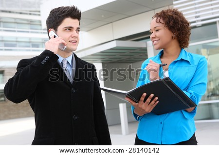 Attractive man and woman business team at work - stock photo