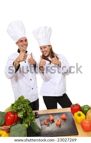 Attractive man and woman chefs celebrating success - stock photo