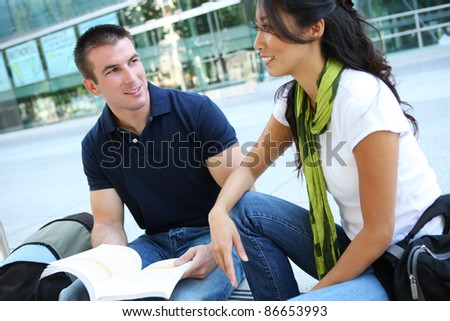 Attractive Man and Woman couple at School Library - stock photo