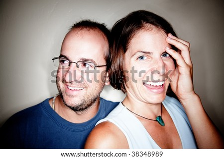 Attractive Man and Woman Smiling in Closeup Shot - stock photo