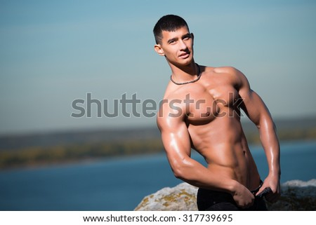 Attractive man, athletic build, sport, fitness, lifestyle - Fashion portrait of a sporty, athletic, muscular sexy man