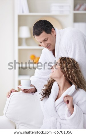 Attractive man brought his wife coffee - stock photo
