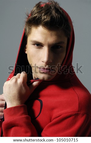 attractive man close up portrait on gray background - stock photo