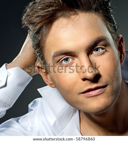 attractive man close up portrait on grey background - stock photo