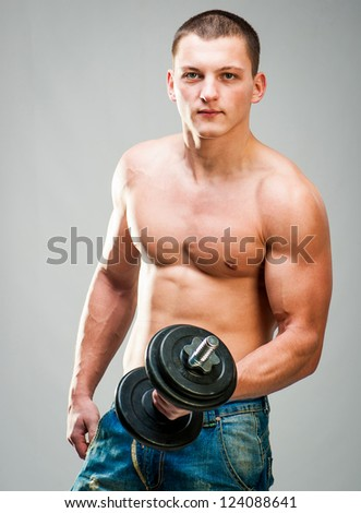 attractive man doing biceps exercise with dumbbells - stock photo