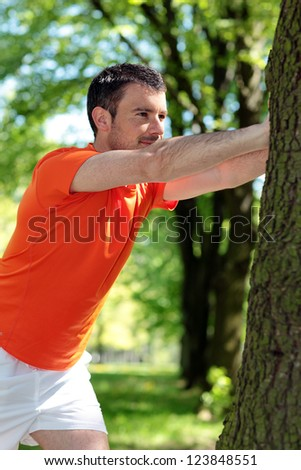attractive man doing sport in a park - stock photo