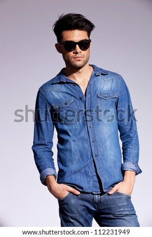 attractive man dressed casually in a jeans shirt,  wearing sunglasses