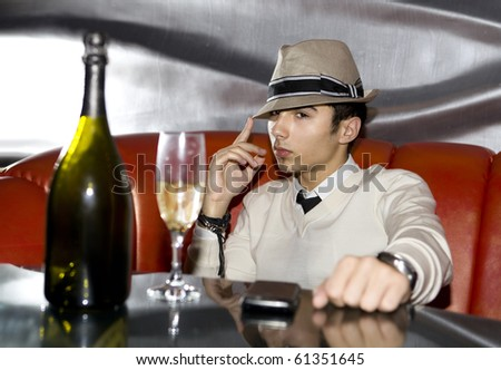 Attractive man drinking in cocktail party at night club
