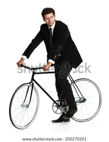 Attractive man in a classic suit with a bicycle on a white background - stock photo