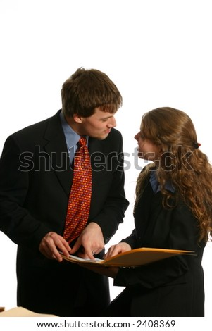 Attractive man in business suit explaining documents - stock photo