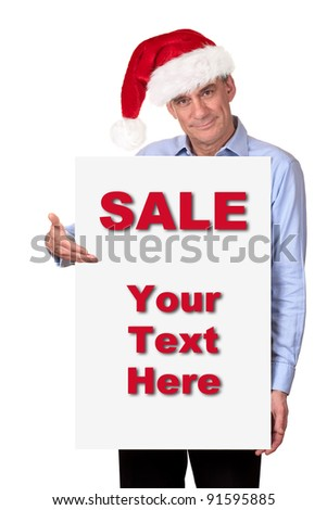 Attractive Man in Santa Hat Holding Blank White Sign - stock photo