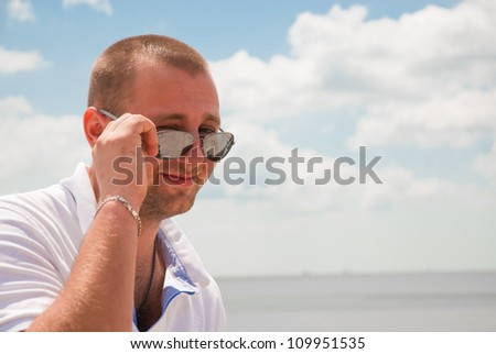 attractive man laughing against blue sky