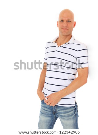 Attractive man leaning to wall. All on white background. - stock photo