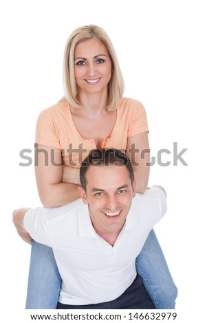 Attractive Man Piggybacking His Pretty Girlfriend Isolated Over White Background - stock photo