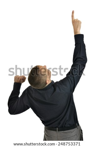 Attractive man pointing up on white background - stock photo