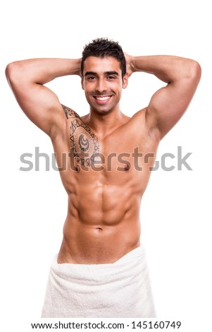 Attractive man posing with a white towel - stock photo