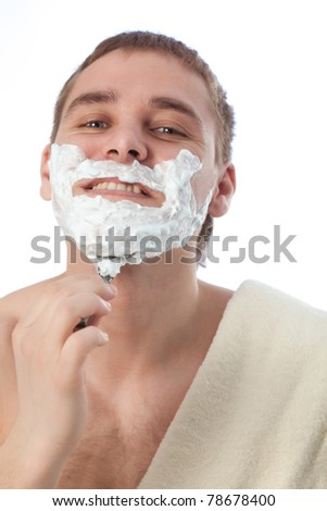 attractive man shaving his face over white