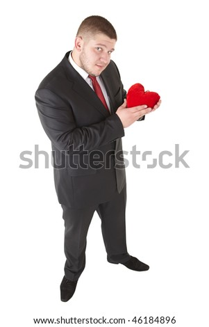 Attractive  man showing  heart in his hand. Isolated over white. - stock photo