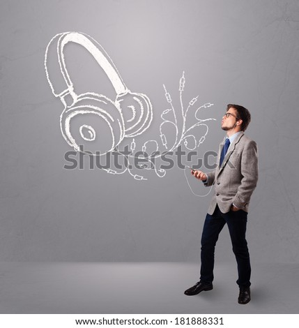 attractive man singing and listening to music with abstract headphone getting out of his mouth - stock photo