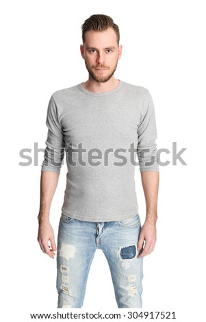 Attractive man standing with a white background wearing a grey shirt, looking focused. - stock photo
