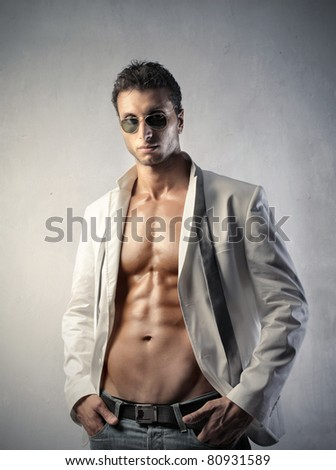 Attractive man wearing an open shirt - stock photo
