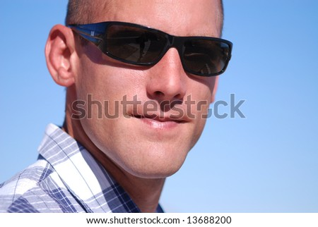 Attractive man wearing sunglasses.