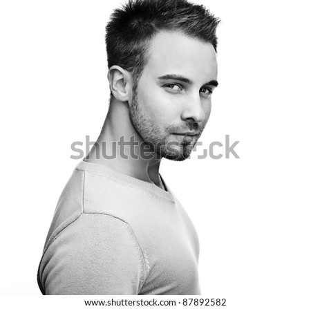 Attractive man wearing sweater - close up portrait on white background. Black-white photo. - stock photo