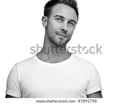 Attractive man wearing T-shirt close up portrait on white background. Black-white photo. - stock photo