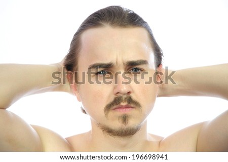 Attractive man  with arms behind his head isolated - stock photo