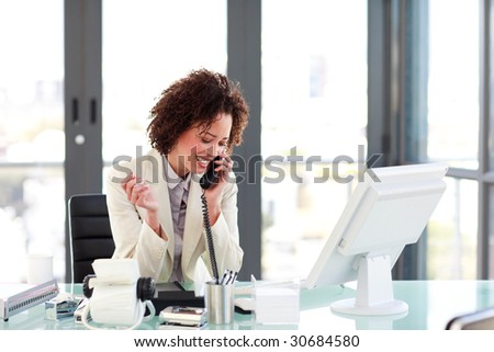 Attractive manager speaking on the phone - stock photo